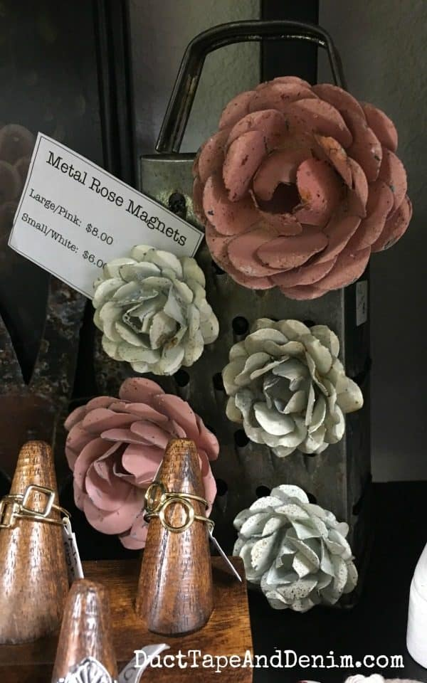 Metal rose magnets on my shelf at Paris Flea Market | DuctTapeAndDenim.com
