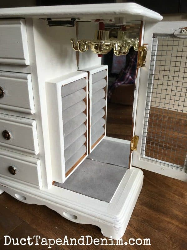 Inside my jewelry cabinet makeover with chalky finish paint. More on DuctTapeAndDenim.com