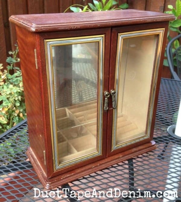 BEFORE - This is the two-door jewelry cabinet I found at Goodwill before painting it with my homemade chalk paint. Celebrate National Craft Month with DuctTapeAndDenim.com