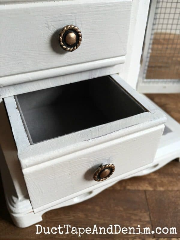 Close up of drawer and handle on my thrift store jewelry cabinet makeover. More on DuctTapeAndDenim.com
