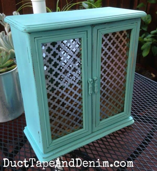 Finished jewelry cabinet makeover. Found at thrift store. See complete tutorial with homemade chalk paint at DuctTapeAndDenim.com