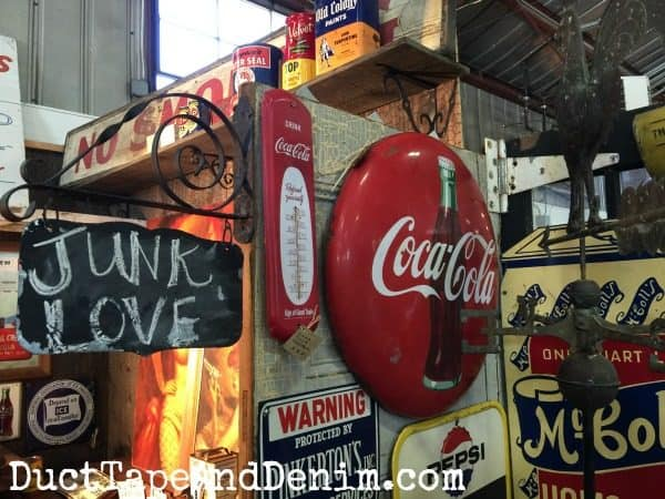 Junk Love at Roses and Rust Vintage Market. Love the antique Coca-Cola signs! DuctTapeAndDenim.com