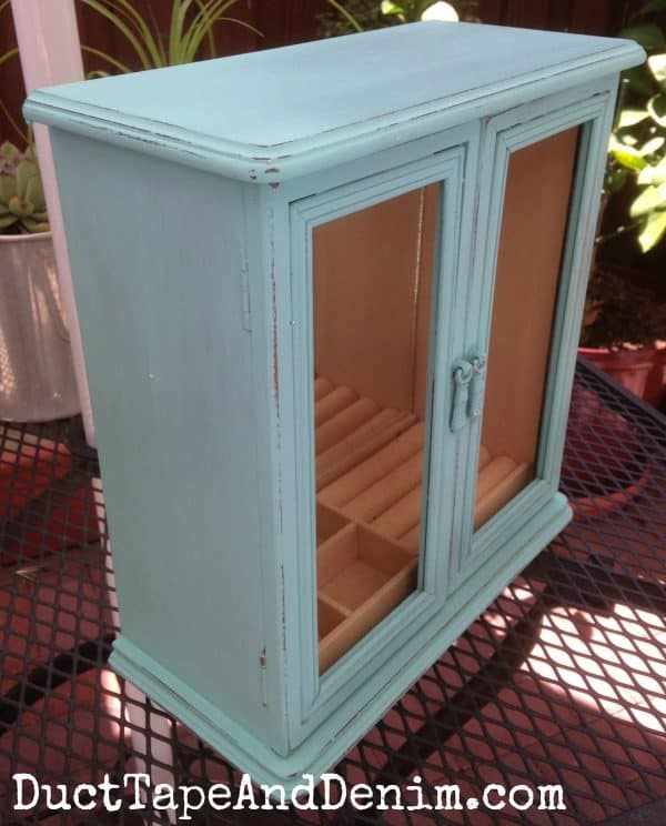 My thrift store find jewelry cabinet after painting with homemade chalk paint and a little distressing. Not finished yet! Celebrate National Craft Month with DuctTapeAndDenim.com