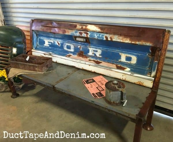 Repurposed Ford pickup truck tailgate bench at Roses and Rust Vintage Flea Market | DuctTapeAndDenim.com