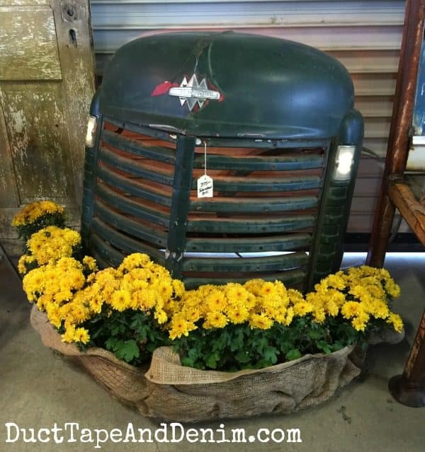 Tractor grill repurposed planter at Roses and Rust Vintage Flea Market | DuctTapeAndDenim.com