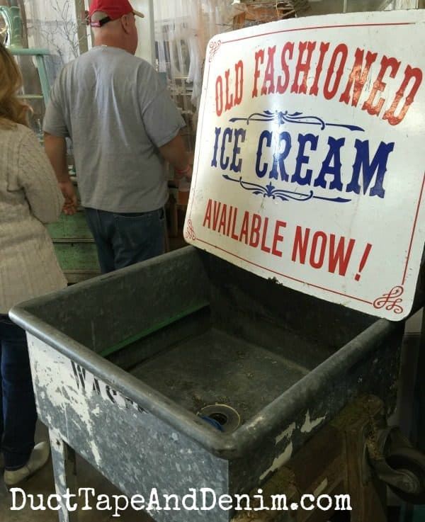 Vintage ice cream sign and antique sink at Roses and Rust Vintage Market | DuctTapeAndDenim.com