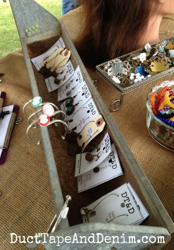 Earrings displayed in vintage farmhouse chicken feeders at Antique Alley Texas flea market | DuctTapeAndDenim.com
