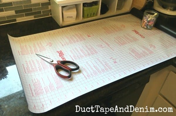 Rolled out Contact Paper on my counter to cut the menu planner | DuctTapeAndDenim.com