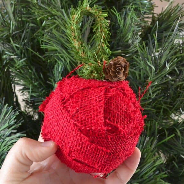 DIY rustic burlap Christmas ball ornaments. More ornament ideas on DuctTapeAndDenim.com