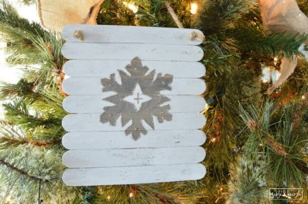 DIY planked snowflake ornaments. More Christmas ornament ideas on DuctTapeAndDenim.com