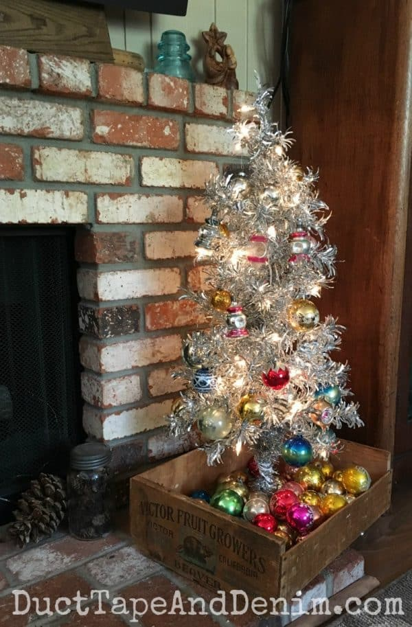 Aluminum Christmas tree in vintage crate with Shiny Brite ornaments | DuctTapeAndDenim.com