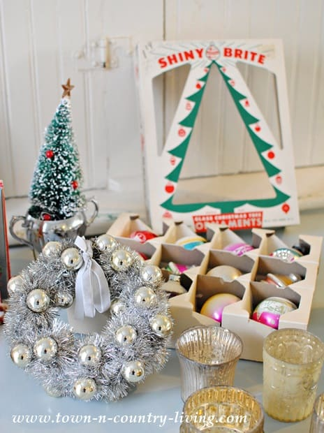 Display vintage Shiny Brite ornaments in their box. More Christmas ideas on DuctTapeAndDenim.com
