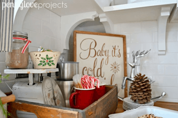 Hot chocolate bar in vintage crate. More farmhouse Christmas decor ideas on DuctTapeAndDenim.com