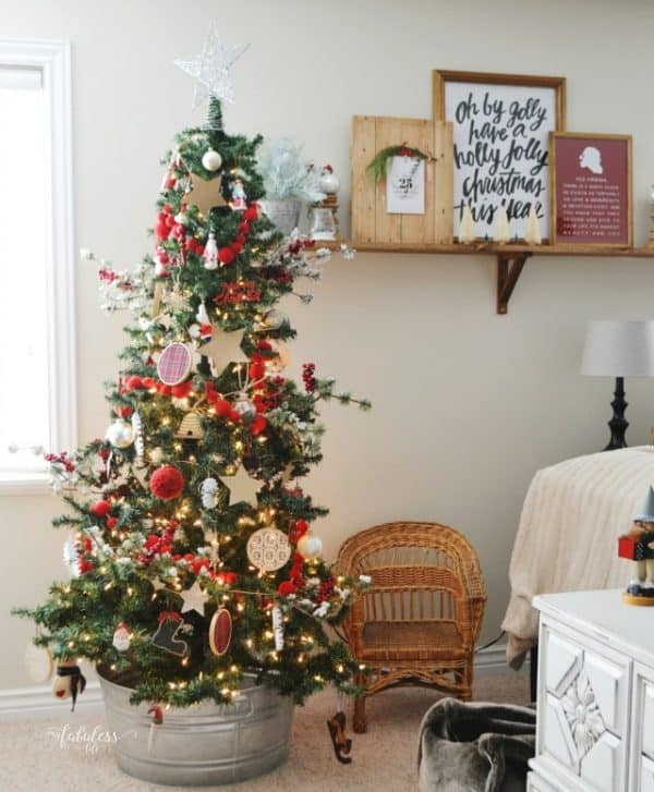 Christmas tree in galvanized tin bucket. More farmhouse Christmas decor ideas on DuctTapeAndDenim.com
