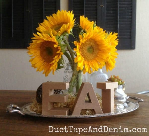 Sunflower vignette with thrift store finds | DuctTapeAndDenim.com