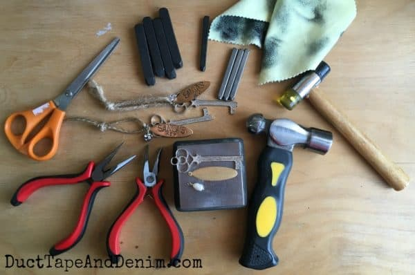Supplies needed to make Santa's Key ornament. More DIY ornaments on DuctTapeAndDenim.com