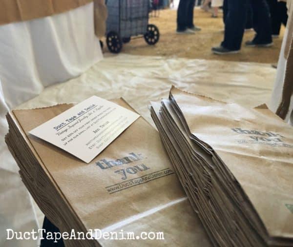 Stuffing bags for the flea market. Vintage Market Days Waxahachie Texas | DuctTapeAndDenim.com