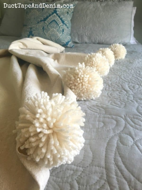 DIY pom pom throw blanket, drop cloth challenge | DuctTapeAndDenim.com
