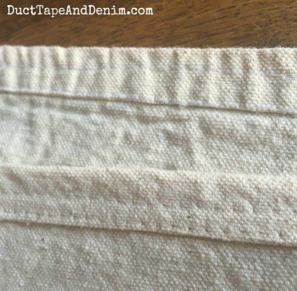 Hemmed edge of drop cloth throw blanket | DuctTapeAndDenim.com
