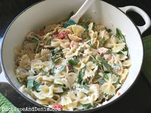 Mixing my Caesar chicken pasta | DuctTapeAndDenim.com