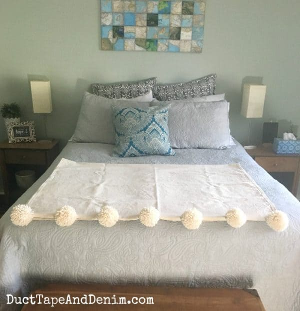 Pom pom throw blanket on bed, drop cloth | DuctTapeAndDenim.com