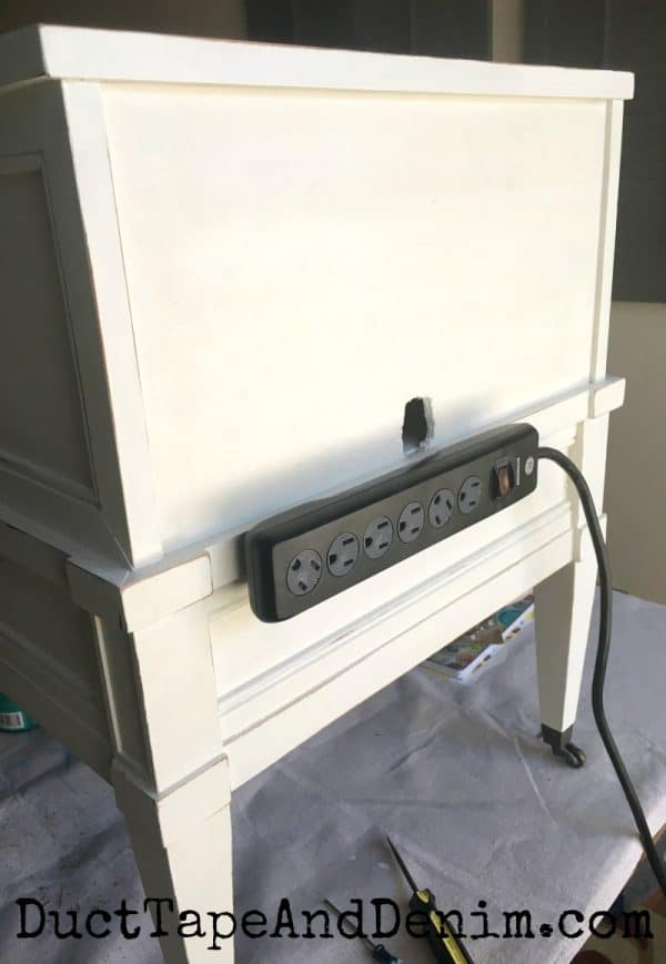 Power strip on back of thrift store table makeover | DuctTapeAndDenim.com