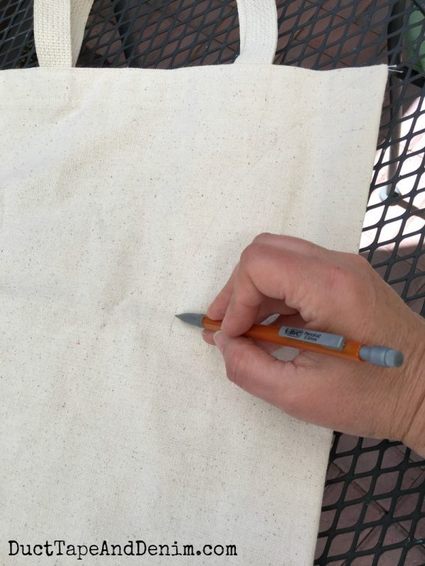 Drawing lines for embroidering baseball tote bag | DuctTapeAndDenim.com