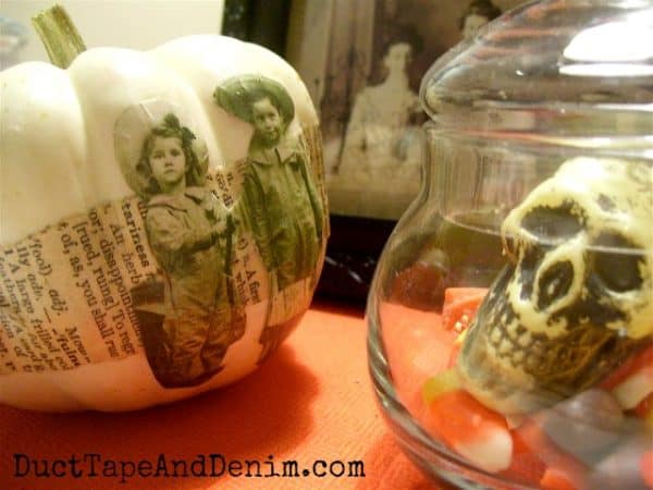 Decoupaged pumpkin with skull at Halloween. DuctTapeAndDenim.com