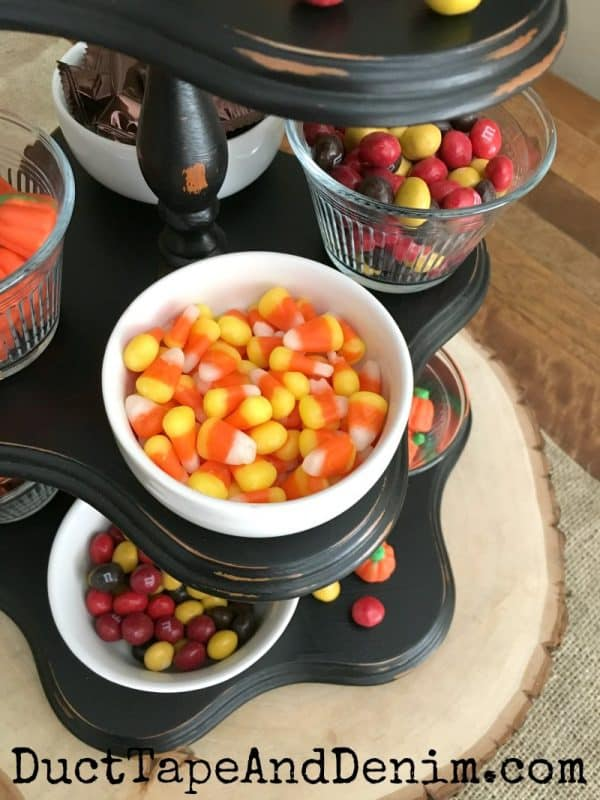 Fall candy displayed on thrift store wood cupcake stand | DuctTapeAndDenim.com