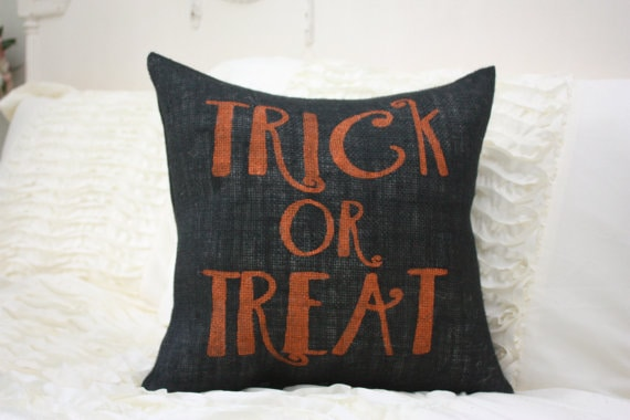 Trick or treat orange on black burlap Halloween pillow.
