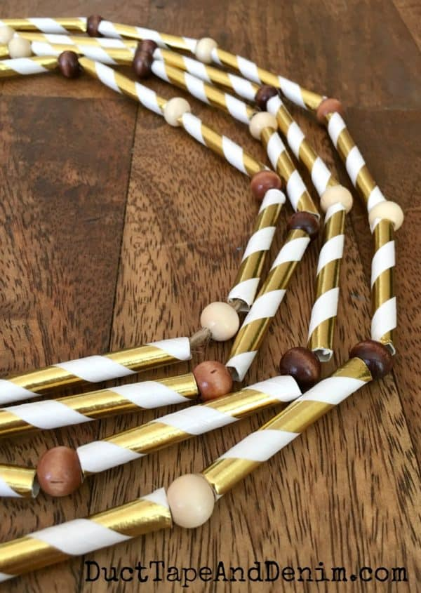 Finished gold striped paper straw garland for my Thanksgiving decorations | DuctTapeAndDenim.com