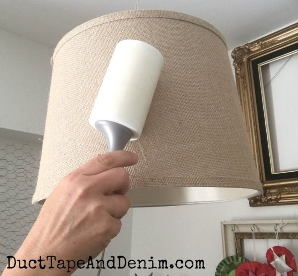 Cleaning lampshade with lint roller. 6 Things to Clean in Your Craft Room with a Lint Roller. | DuctTapeAndDenim.com