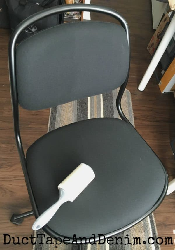 Cleaning my office chair with lint roller. 6 Things to Clean in Your Craft Room with a Lint Roller. | DuctTapeAndDenim.com