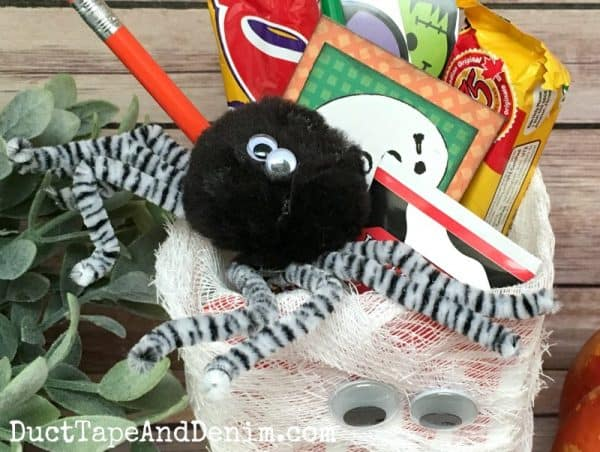 DIY Pom Pom Spider. Idease for Halloween Boo Baskets on DuctTapeAndDenim.com