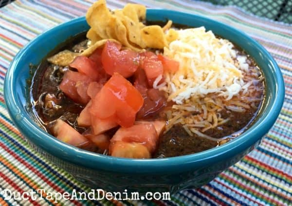 Simple Texas chili recipe served with tomatoes, Fritos, and shredded cheese | DuctTapeAndDenim.com