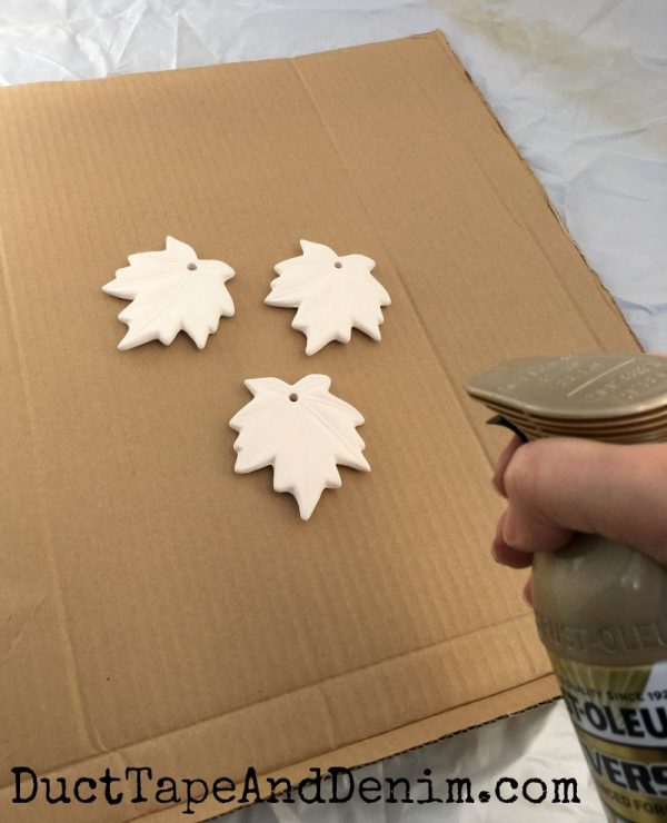 Spray painting my ceramic leaf ornaments | DuctTapeAndDenim.com