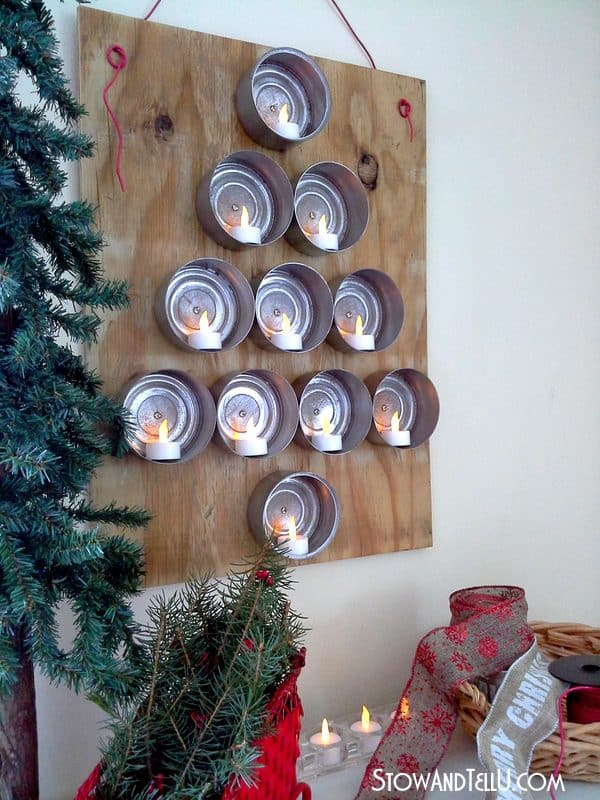 Repurposed wood and tuna cans make this unique can Christmas tree. More upcycled Christmas decor & decorations on DuctTapeAndDenim.com