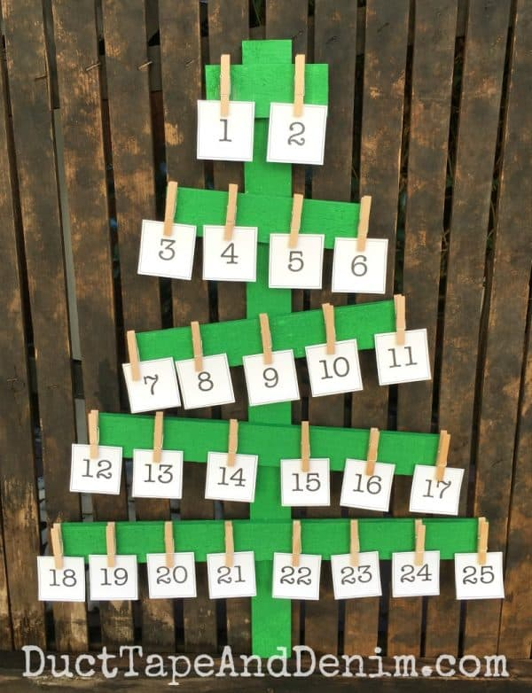 Advent calendar on rustic green wood Christmas tree | DuctTapeAndDenim.com