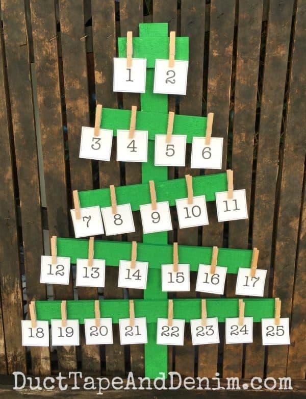 Advent calendar on rustic green wood Christmas tree | DuctTapeAndDenim.com
