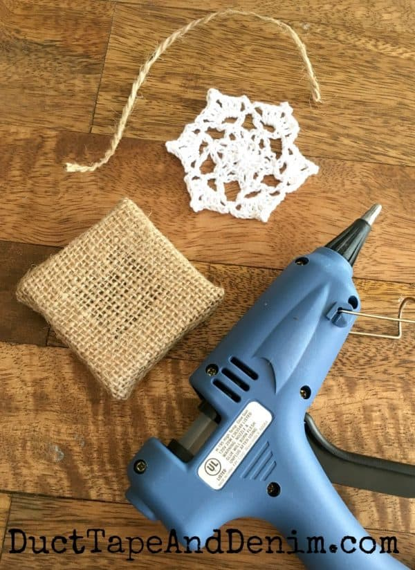 Supplies for doily Christmas ornaments. Tutorial on DuctTapeAndDenim.com