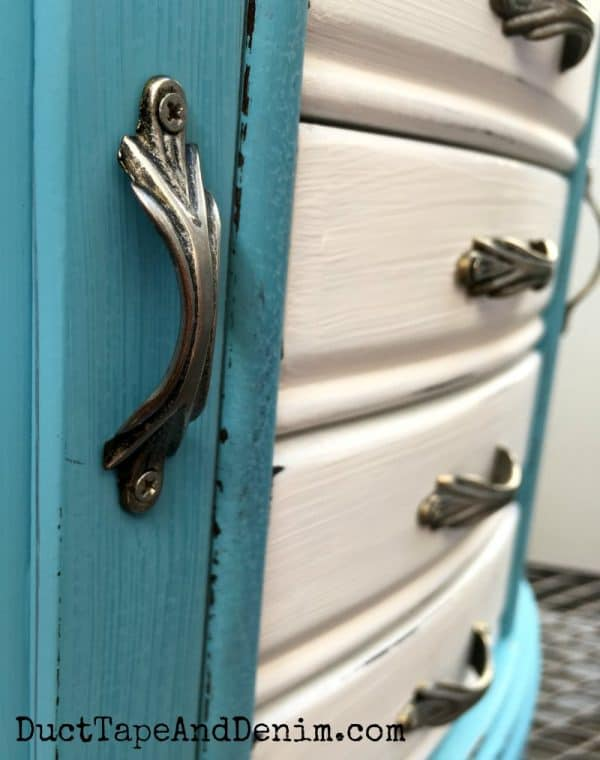 Close up of handles on thrift store jewelry cabinet makeover. DuctTapeAndDenim.com