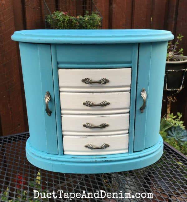 Finished turquoise and white jewelry cabinet from the thrift store. Supplies and instructions on DuctTapeAndDenim.com