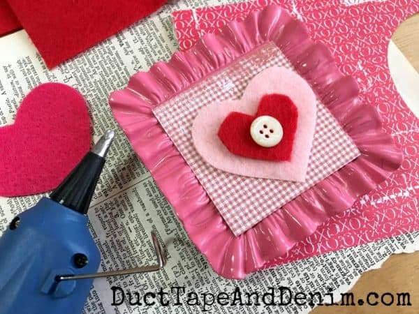 Gluing felt valentines in mini frames for Valentine's Day | DuctTapeAndDenim.com