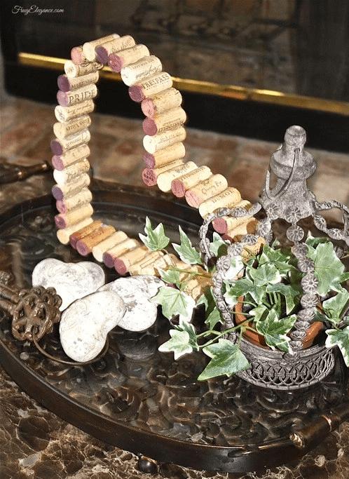 Wine cork heart wreath. More DIY Valentine wreath ideas on DuctTapeAndDenim.com