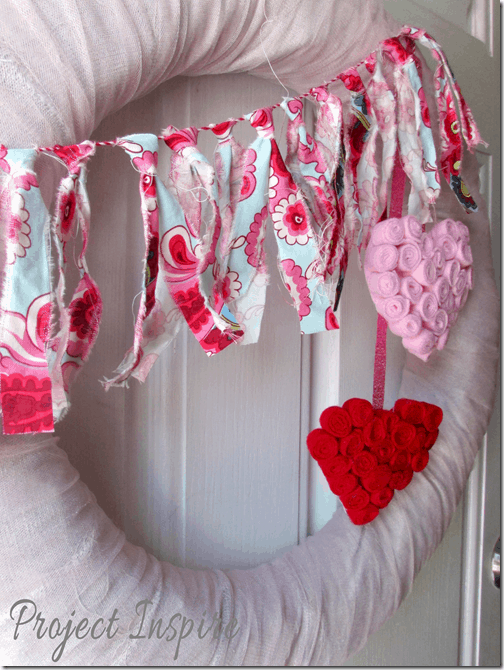 Valentine's Day wreath, fabric scrap garland. More wreath ideas on DuctTapeAndDenim.com