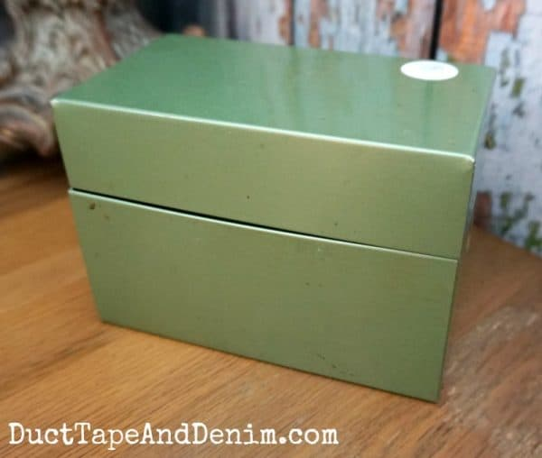 Vintage metal recipe file box BEFORE makeover. More thrift store makeovers at DuctTapeAndDenim.com