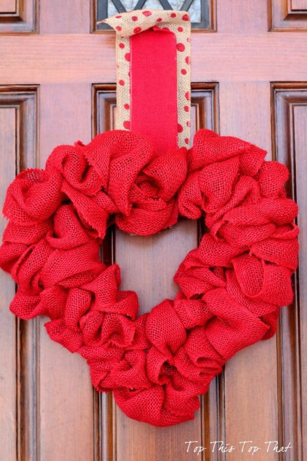Red burlap valentine wreath. More DIY Valentine's Day wreath ideas on DuctTapeAndDenim.com