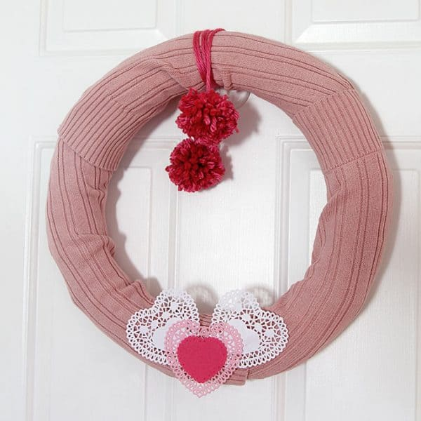 PINK sweater wreath for valentine's day. More DIY wreath ideas on DuctTapeAndDenim.com