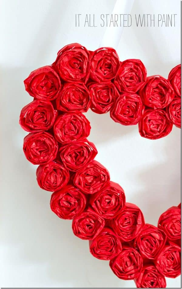 tissue paper rose heart wreath. More Valentine's Day wreaths on DuctTapeAndDenim.com