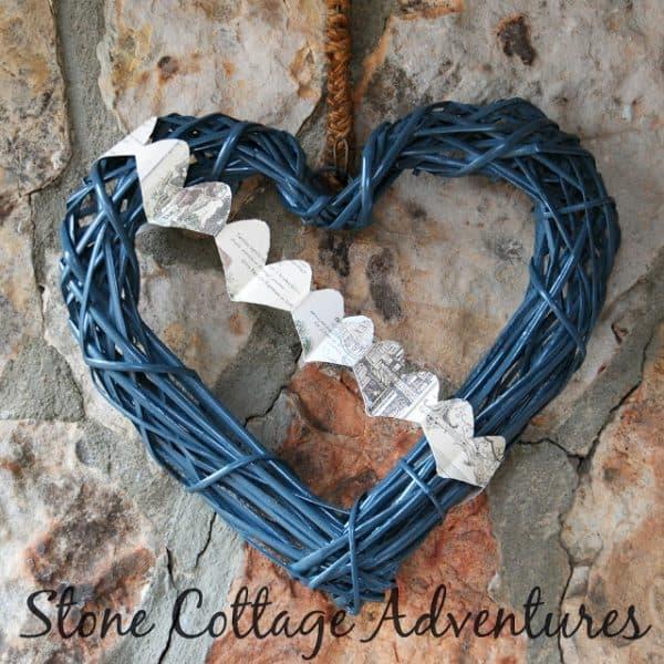 Black vine heart wreath. More DIY Valentine's Day wreaths on DuctTapeAndDenim.com